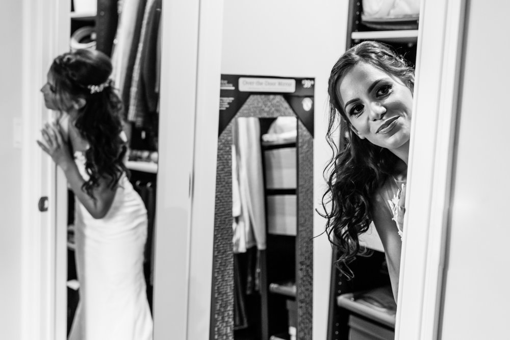 Stefy Hilmer Photography-bride is hiding from the bridesmaids not to spoil the surprise of her dress.jpg