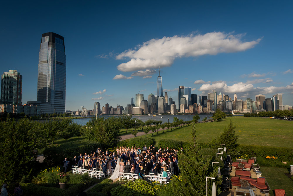 Stefy Hilmer Photography-overview of bride walking down the aisle with in front of the NYC skyline.jpg