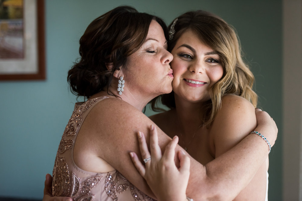 Stefy Hilmer Photography-mother of the bride hugging her daughter.jpg