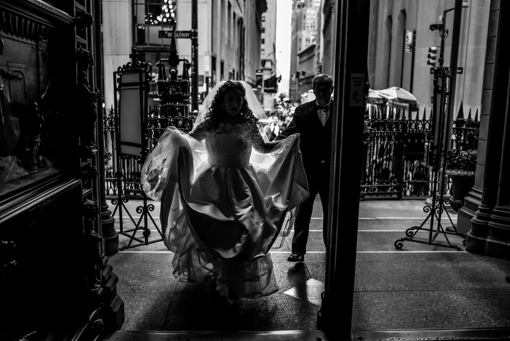 Stefy Hilmer Photography-bride is walking into trinity church in NYC for her ceremony.jpg