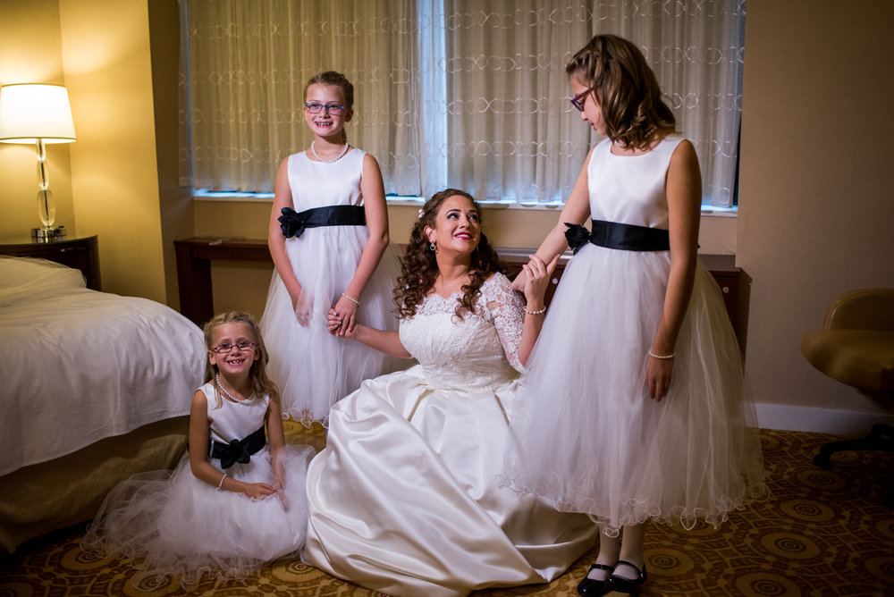 Stefy Hilmer Photography-bride is taking a photo with her flowergirls.jpg