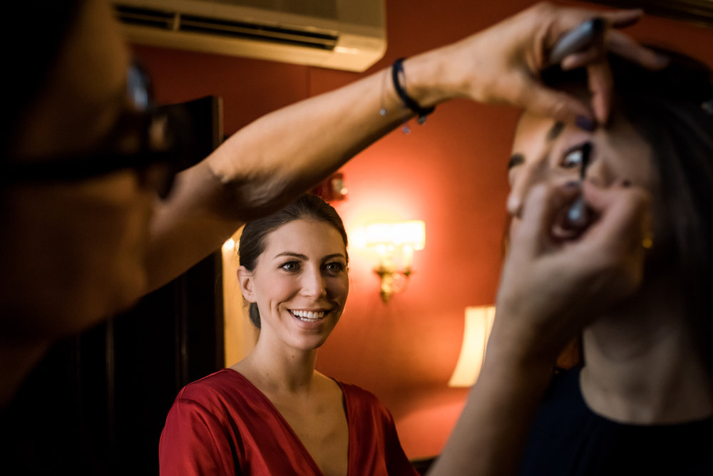 Stefy Hilmer Photography-bride is watching bridesmaids getting their hair and make up done.jpg