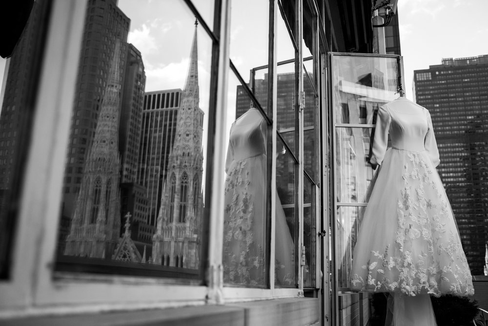 Stefy Hilmer Photography-wedding dress photo with st. patrick cathedral in the window reflection.jpg