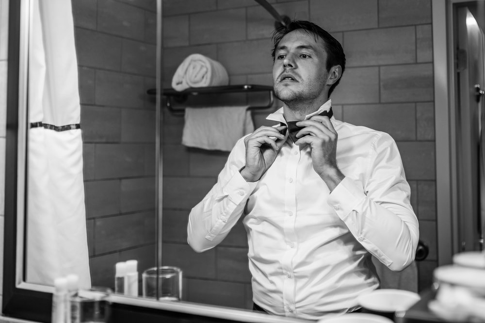 Stefy Hilmer Photography-groom is putting on attire for wedding day.jpg