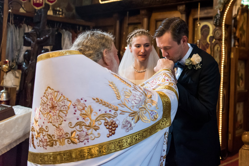 Stefy Hilmer Photography-groom is kissing the priests hand.jpg
