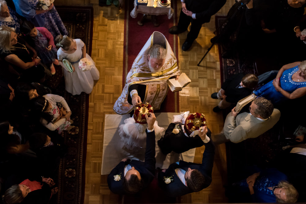 Stefy Hilmer Photography-priest is blessing bride and groom in russian orthodox church in NY.jpg