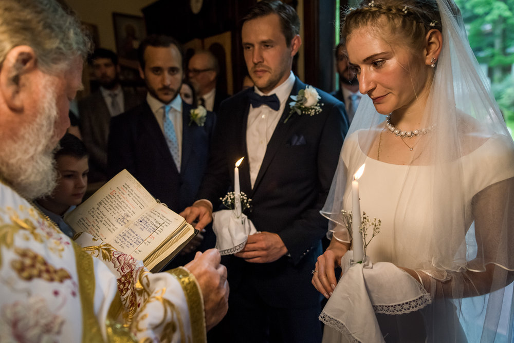 Stefy Hilmer Photography-prist is reading prayer to bride and groom in russian orthodox church.jpg