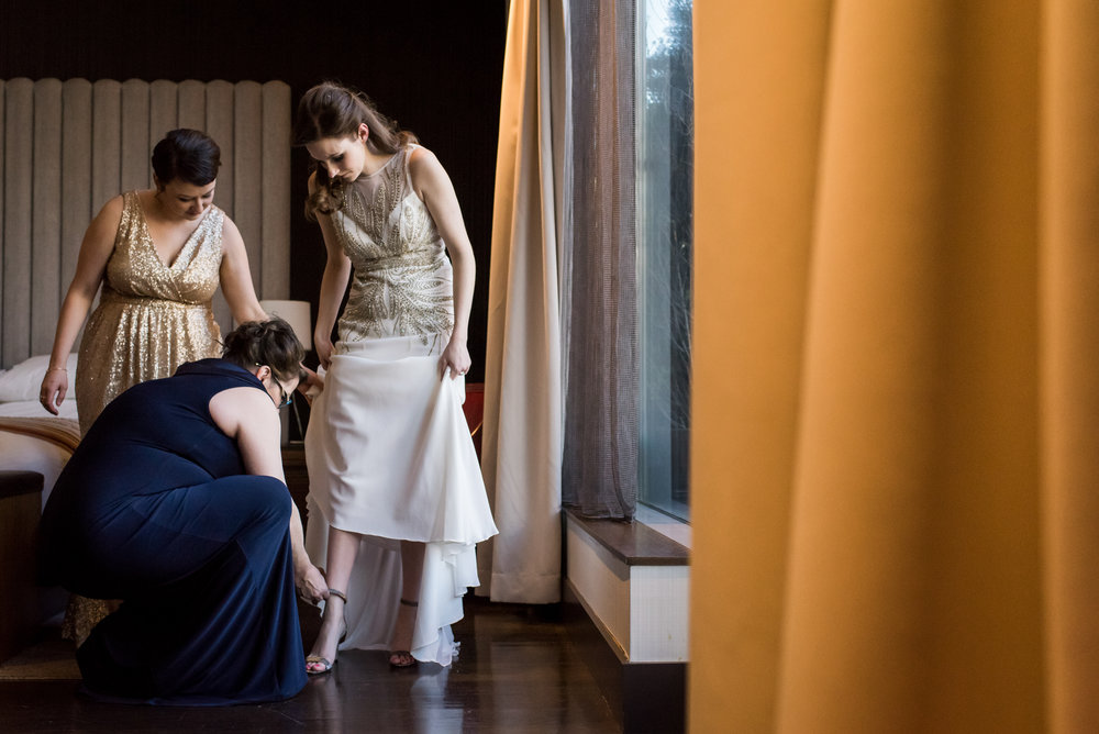 Stefy Hilmer Photography-bride getting into her wedding dress.jpg