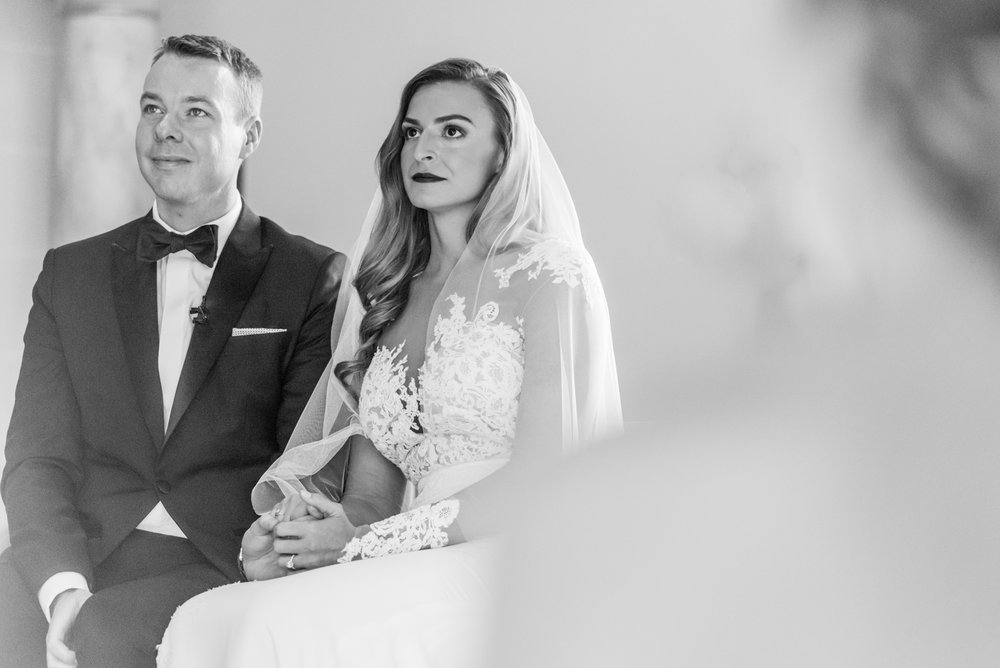 Stefy Hilmer Photography-bride and groom listening to the priest in the Beacon church in NY.jpg