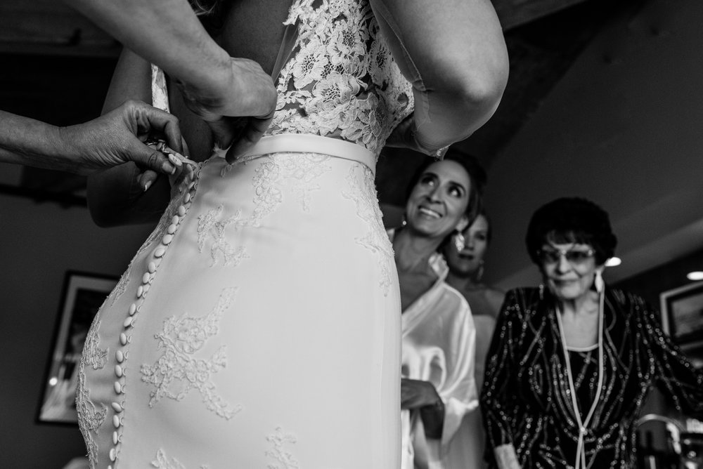 Stefy Hilmer Photography-bride is getting into her dress.jpg
