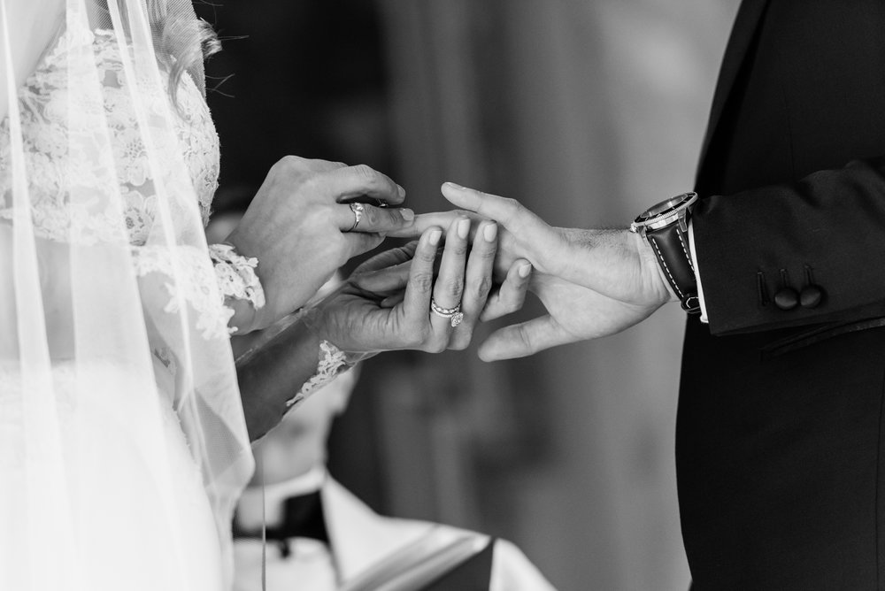 Stefy Hilmer Photography-bride is putting ring on her husbands finger.jpg