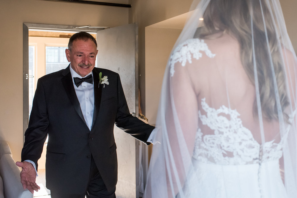 Stefy Hilmer Photography-father of the bride is seeing his daughter for in her wedding dress for the first time.jpg