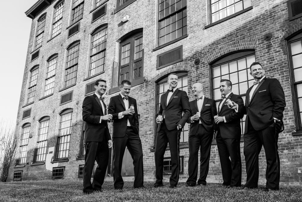 Stefy Hilmer Photography-groomsmen photo in front of brick building.jpg