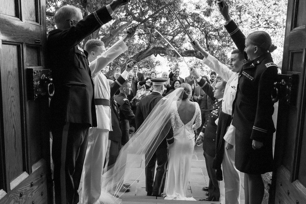 Stefy Hilmer Photography-bride and groom leaving chapel with sword arch.jpg