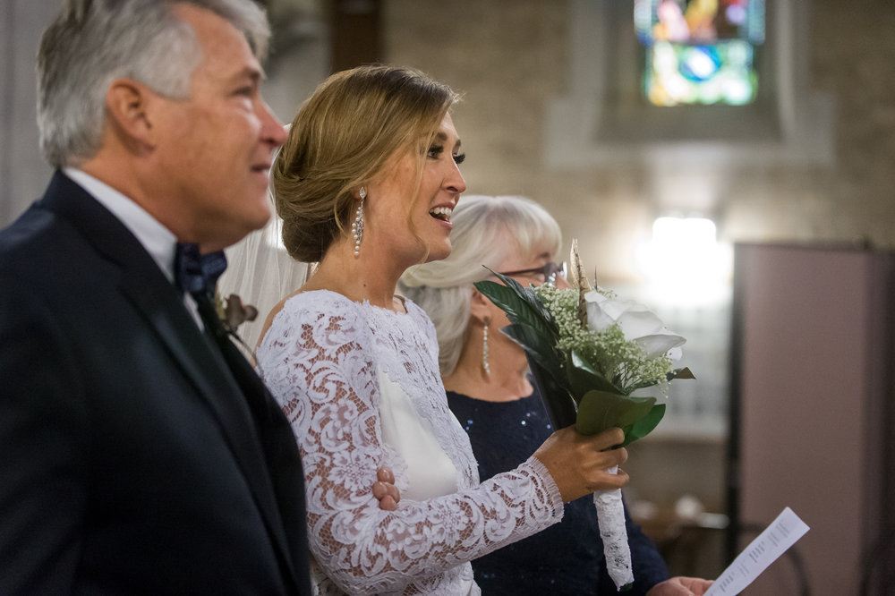 Stefy Hilmer Photography-bride walking dows the aisle with her parents.jpg