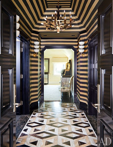 black and gold striped hallway - kelly wearstler
