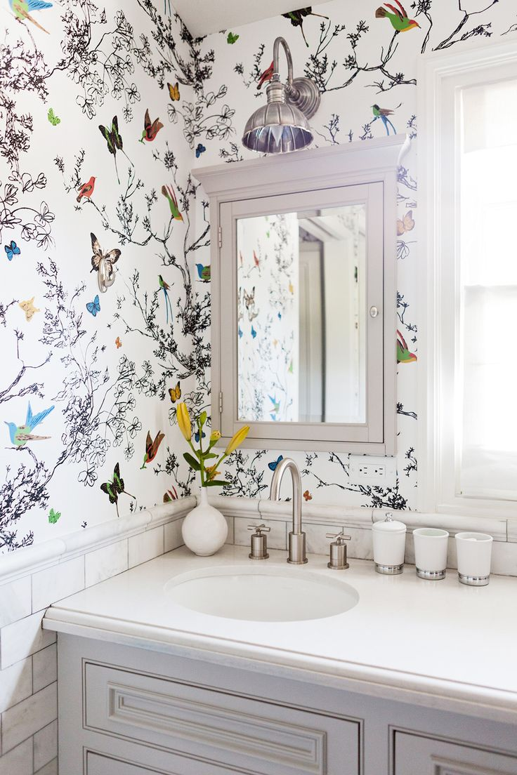colorful wallpaper in neutral bathroom