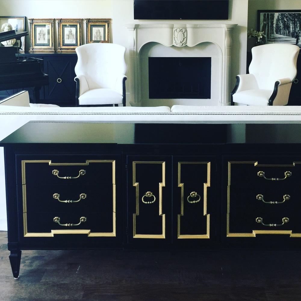 black and gold dresser