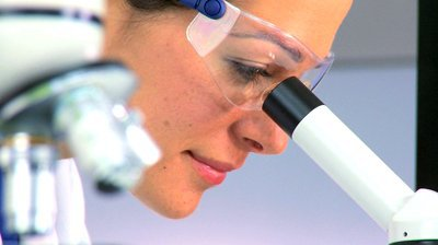 stock-footage-female-medical-researcher-checking-scientific-data-with-a-microscope-in-laboratory-conditions.jpg