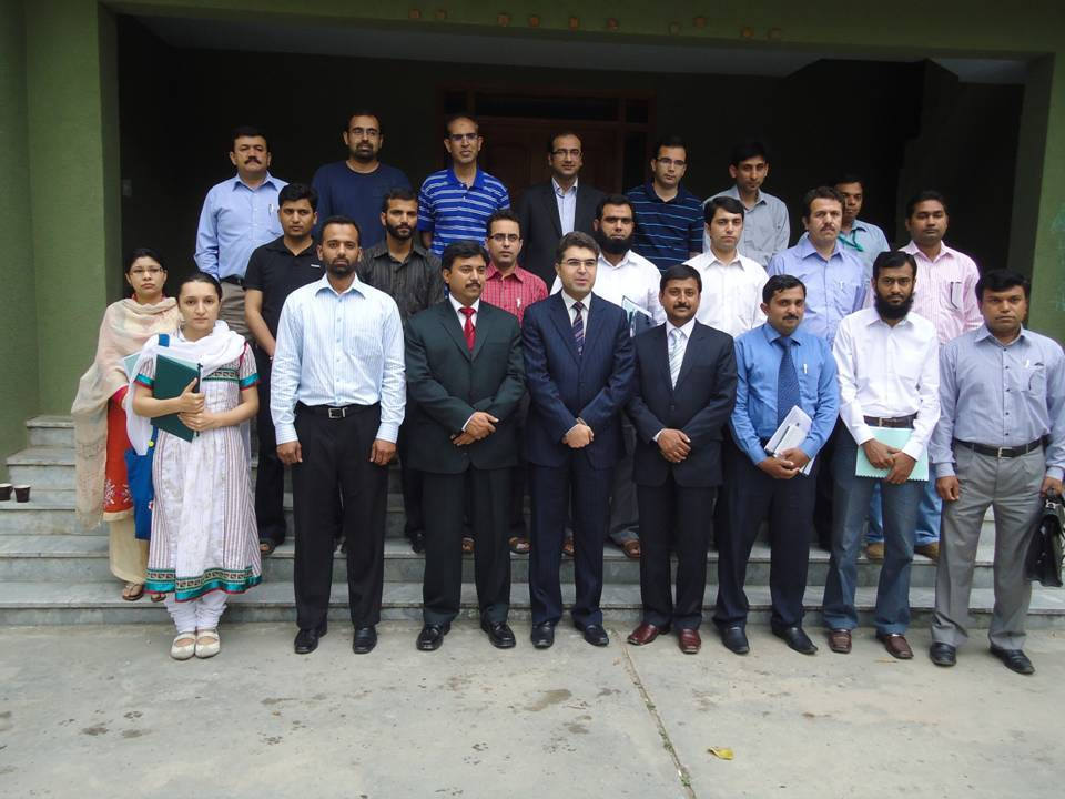 Haider and other anti-fraud professionals at a recent fraud-related training event.