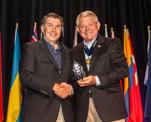 Bill Vasiliou, CFE, accepts the award from ACFE President and CEO Jim Ratley, CFE.
