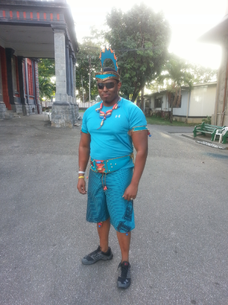 Reid in costume at Trinidad's Carnival celebration.