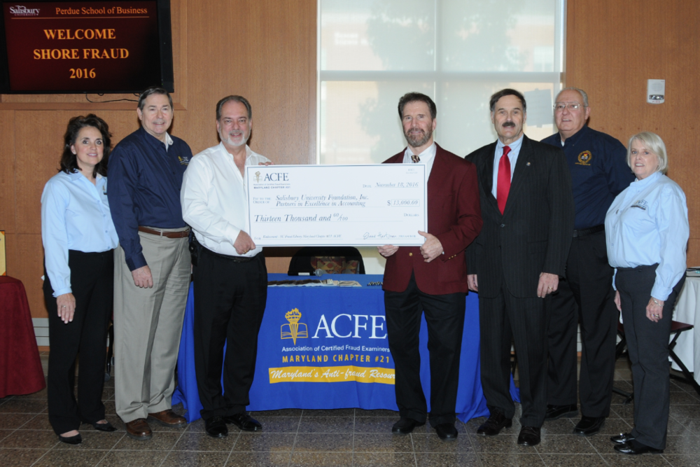 Maryland ACFE Chapter Leaders presenting check to Dr. Ken Smith, Salisbury University