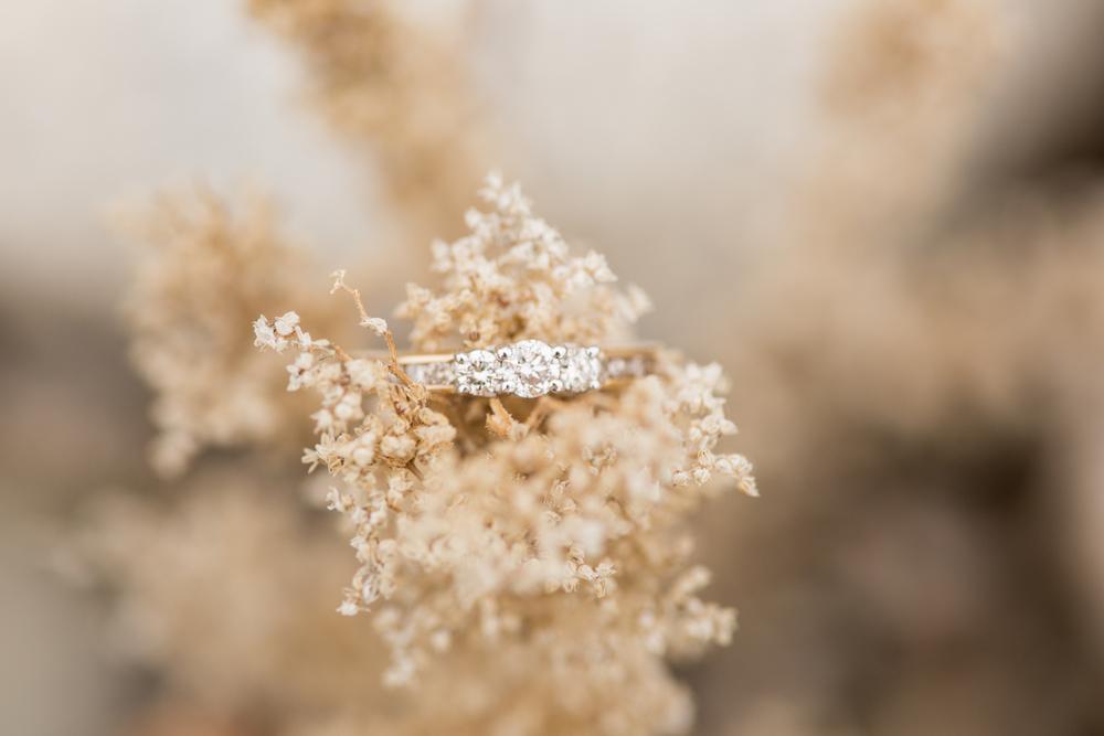 diamond engagement ring shot in flower