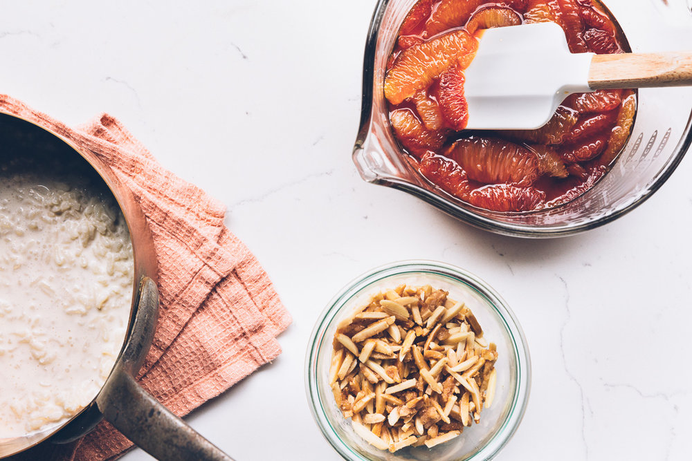 rice pudding with citrus caramel and candied almonds || photo: olaiya land