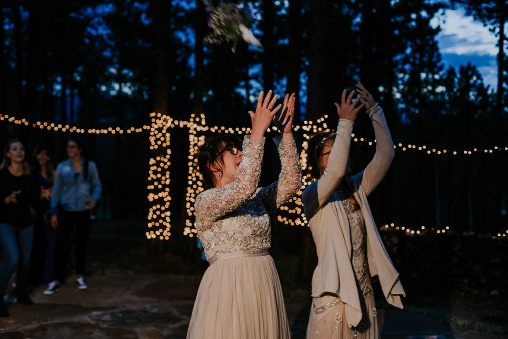 Taos New Mexico Elopement Photographer - tented backyard reception - bouquet toss