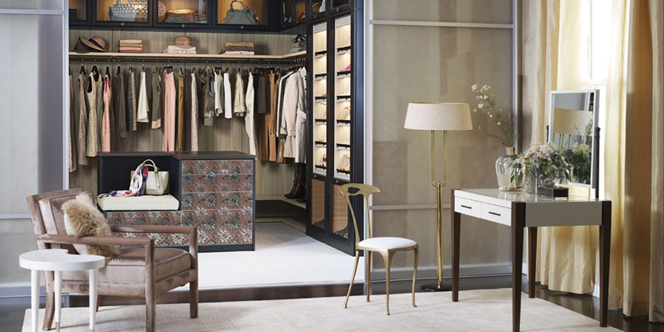 A vintage Italian side chair by Palladio for Wyeth   from  MCMF  adds elegant charm to a walk-in closet by  California Closets .