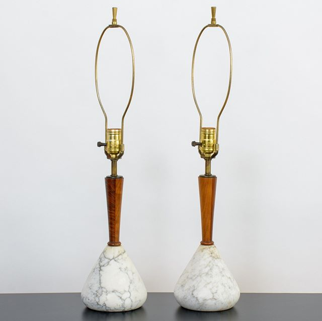 A pair of vintage Mid-Century table lamps with solid marble bases, walnut necks and brass fittings. . . . . #midcenturymodernhome #midcenturymoderntablelamppair #midcenturymodernlamp #marblelamp #vintagemidcenturylamp #bedsidelamps #mcmlamp #midcenturymodernhomedecor #midcenturymodernlighting