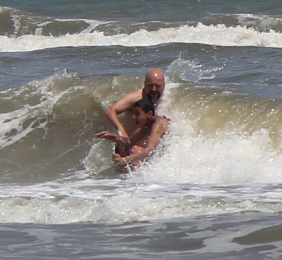 Teaching young Hamza how to body surf.