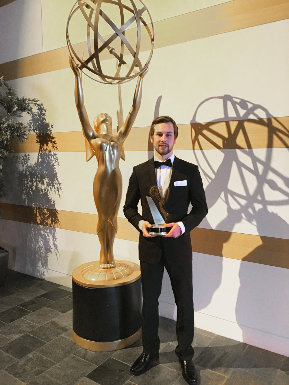 Damenz with his College Emmy.