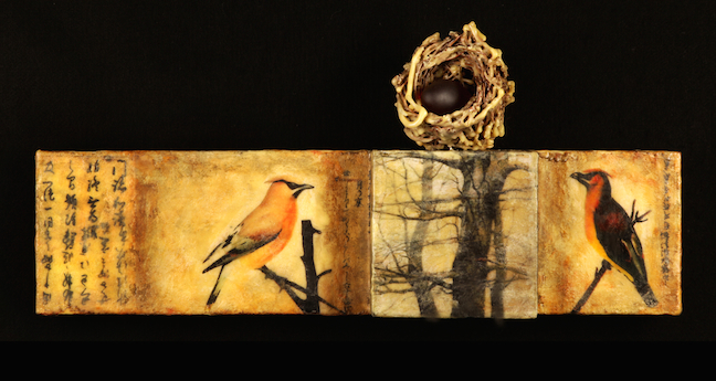 Mixed-media encaustic with raised surfaces, willow nest and glass egg