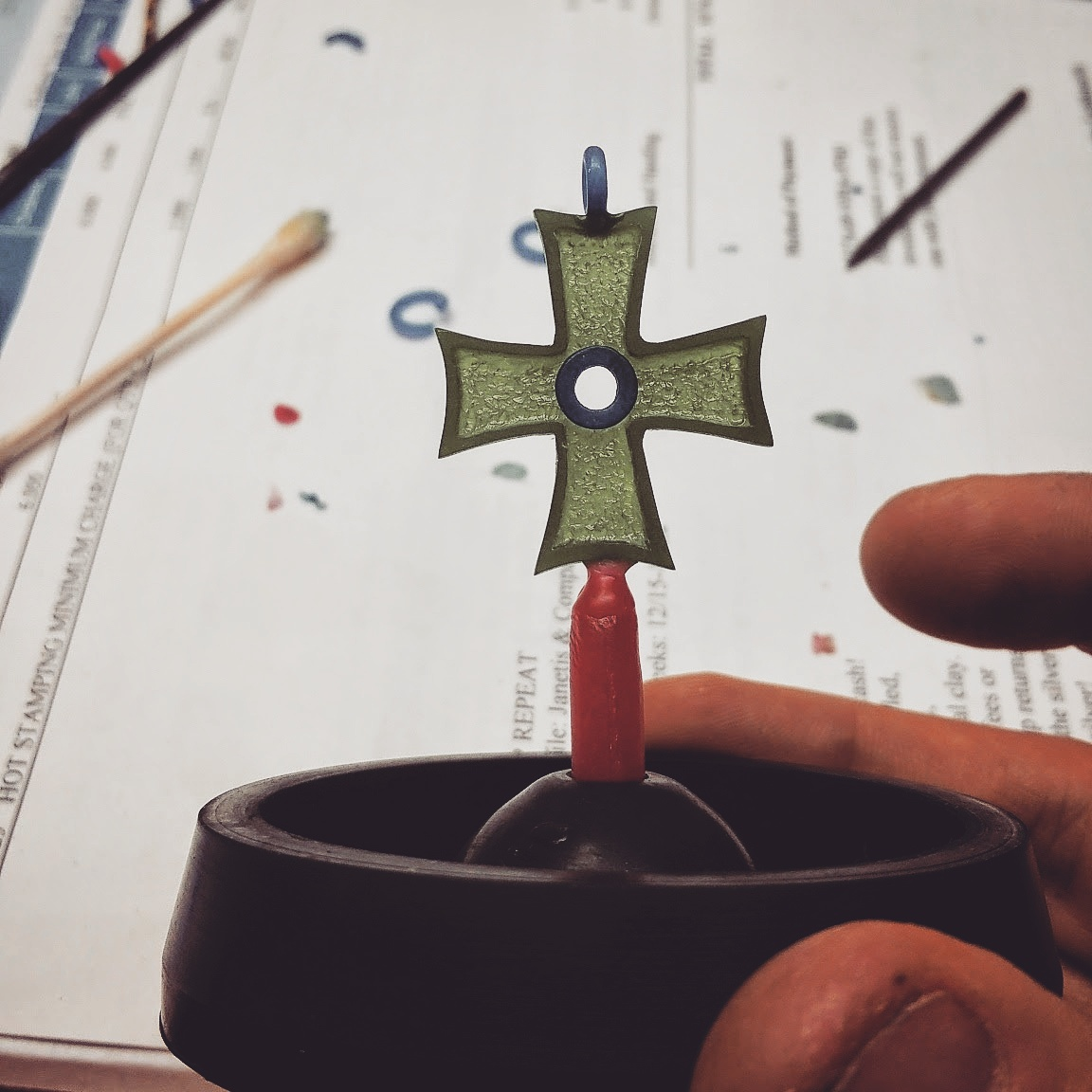 Wax carving of a new greek cross design for the Anastasis collection at J&Co. This cross will be cast in yellow gold and contain a 5mm almandine garnet cabochon as the center stone #janetiscompany #gold #greek #greekcross #cross #JEWELRY #jewelrydesign