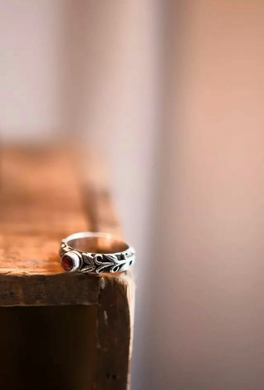 The Zoe ring by J&Co. Zoe is the greek word for life. The Zoe has hand carved vines and grape leaves and contains a 5mm almandine garnet cabochon.