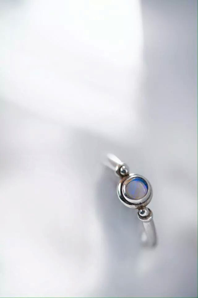 The Katharos ring by J&Co. Katharos is the greek word for pure. This simple yet pure ring is cast in silver and contains a 5mm bezel set opal. #silver #jewelrydesigner #jewelrydesign #organic #mediterranean #opal #janetisandcompany