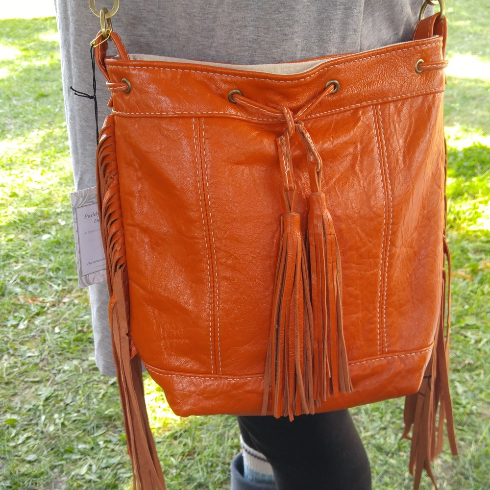 Fringed Diva bag in orange leather