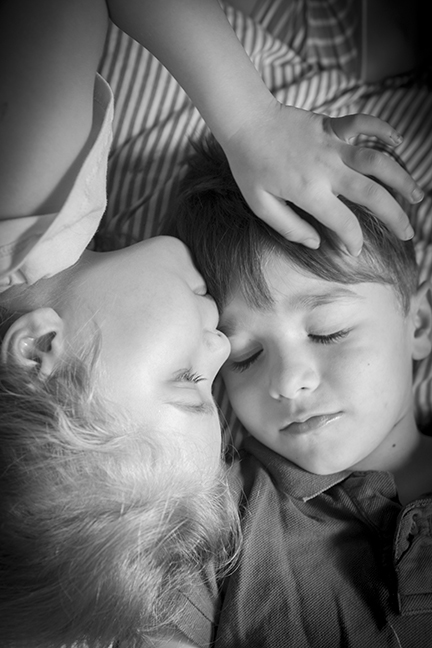 Photographing 3 kids under 6 the morning after halloween was challenging! But in between the chaos, this beautiful moment between twins happened. For all of about 2 seconds... but thats all you need for the perfect keepsake image! Captured at their home.