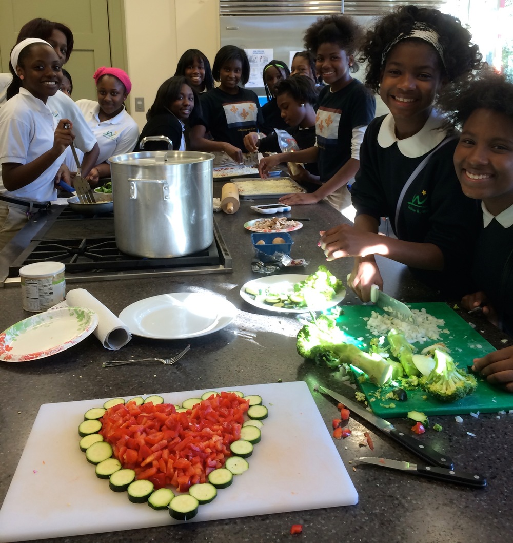 Andrew H. Wilson Charter School students at the Rosa F. Keller Community center prepare an afternoon snack using vegetables from the school garden.