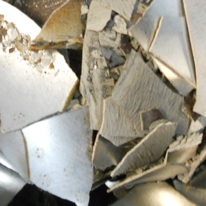 Image of electrolytic silver flake, just one type of silver-bearing scrap that Specialty Metals Smelters and Refiners can recycle for your company.