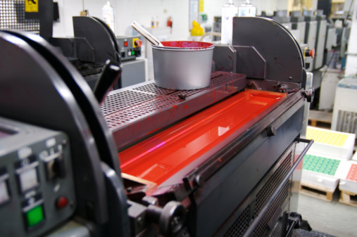 Photo of a printing press showing the magenta ink duct and printing ink, some of which may contain silver particles that can be recycled profitably by Specialty Metals Smelters & Refiners.