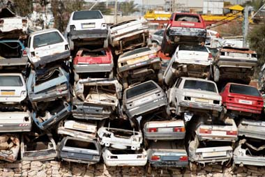 Image of junked cars, which hold a wealth of untapped platinum, palladium, rhodium and other precious metals in their catalytic converters, which Specialty Metals can recycle profitably for you.