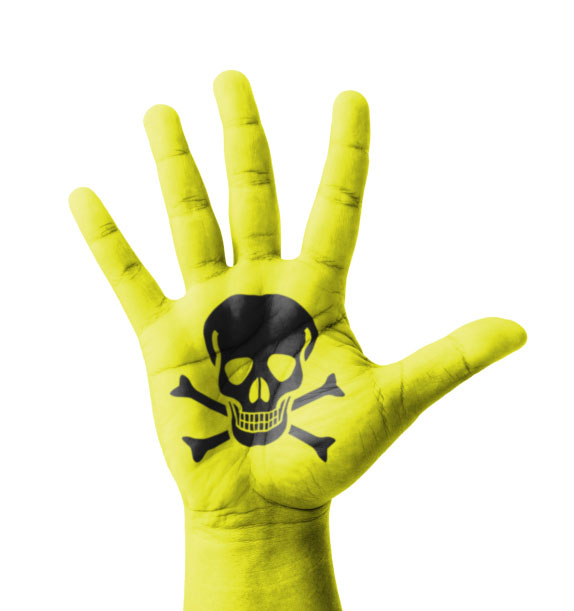 Image of poison skull and crossbones on yellow hand for blog post about how not to poison yourself recycling precious metals. Credit: iJacky/iStock.