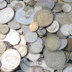 Photo of silver coins that Specialty Metals can recycle and refine for your company.