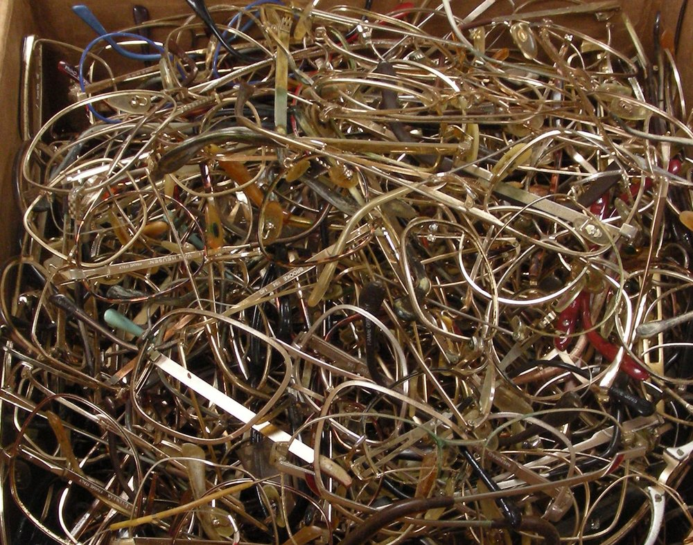 Photo of a shipment of optical and eyeglasses scrap that a customer sent to Specialty Metals for us to recycle, refine and recover gold from.