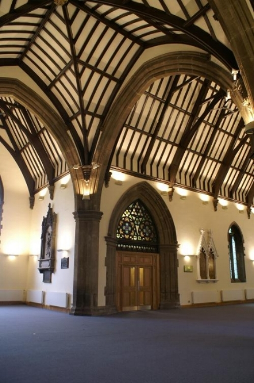Refurbished timber framework and stone arches.