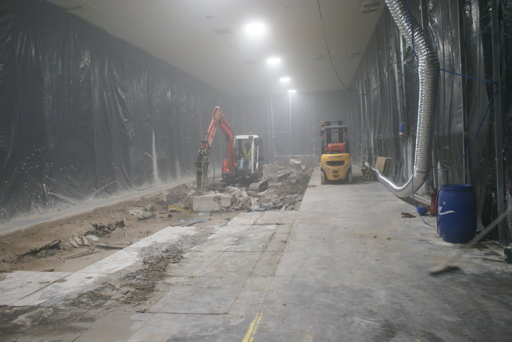 Protective screening is erected to contain the works along with essential temporary ventilation.