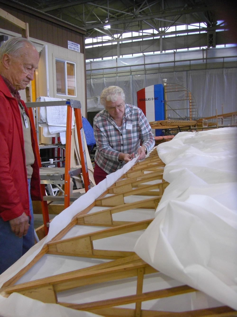 Fred pauses, as beautiful wood wing disappears under a cloud of white fabric